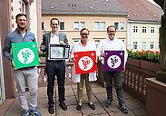 (v.r.) Daniel Jeftic von durlach-gratuliert.de, Ortsvorsteherin Alexandra Ries und Andreas Killet, Firma blukii. Fotos: cg